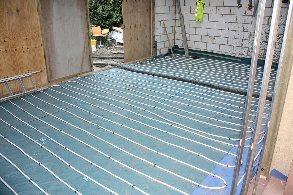 Laying of underfloor heating