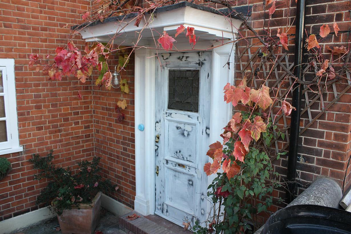 Stripped wooden front door