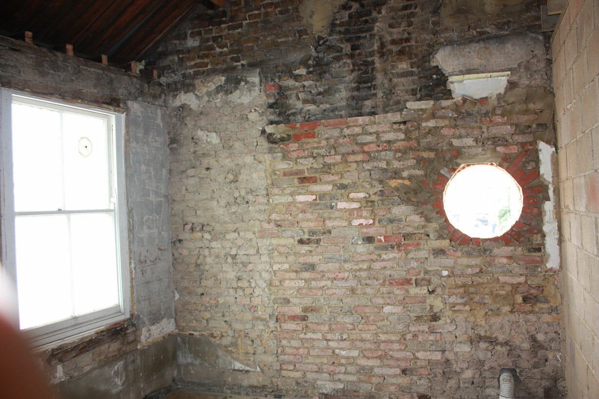 Bare brickwork with round window